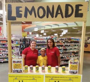 Emily Goodroad (left) and Jenn Wilson of CommunityAmerica Credit Union,  pitching in to help with the Alex's Lemonade Stand fund-raising in Liberty.