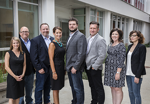 (l-r): Kristin Binford, Integrated Marketing Manager; Chris Langston, Co-Founder; Tim Tuttle, Executive Director;  Kim Laws, Business Development Director; Luke Hurd, Technical Director; Josh Burch, Co-Founder; Kelly Thompson,  Project Management Director; Megan Hopkins, Associate Experience Director.